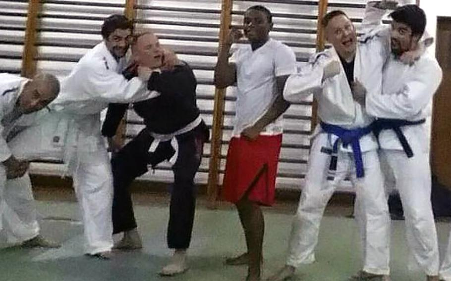 Airman 1st Class Spencer Stone wearing a white belt in black exercise gear is seen in jiu jitsu training session in Portugal where he is stationed at Lajes Field.