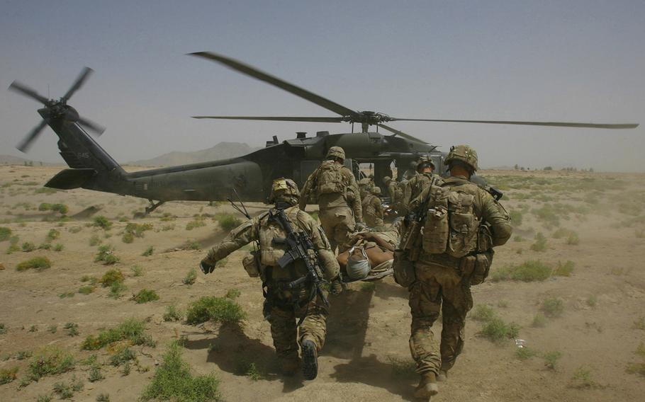 A casualty is evacuated to a medevac helicopter after being injured in an improvised explosive device attack near Molla Dust in Kandahar province Afghanistan on June 15, 2011.