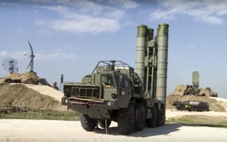 This photo made from the footage taken from Russian Defense Ministry official web site on Friday, Nov. 27, 2015, shows Russian S-400 air defense missiles being deployed at the Hemeimeem air base in Syria, about 50 kilometers (30 miles) south of the border with Turkey.