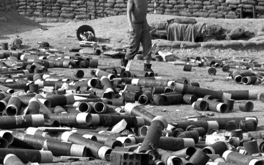 Empty 105mm shell containers litter the ground at the Dak Seang Special Forces camp during a break in the Communist siege of April, 1970.