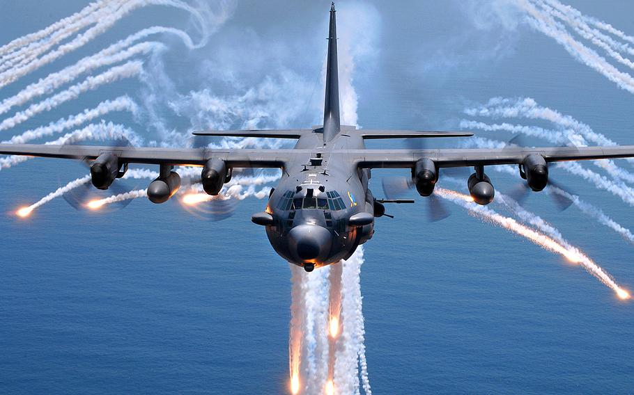An AC-130H gunship jettisons flares as an infrared countermeasure during a training exercise on Aug. 24, 2007.