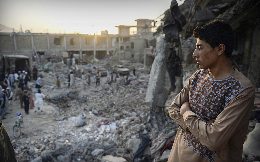 A boy looks across the devastation caused by a massive truck bomb in Kabul, Afghanistan, on Aug. 7, 2015. The bomb primarily struck civilians.