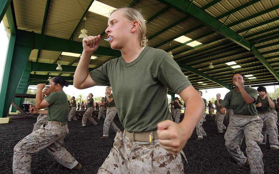 Female Marine recruits practice rear hand punches during training at Parris Island, S.C., in July 2011.