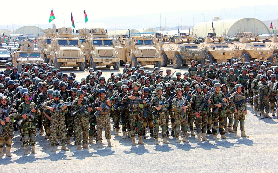 Soldiers from the Afghan National Army's 201 Corps stand formed and ready for inspection in full combat gear at Tactical Base Gamberi July 30, 2015.