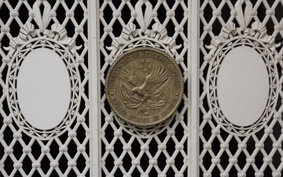 The Department of Veterans Affairs seal on a gate at the agency's headquarters in Washington, D.C.