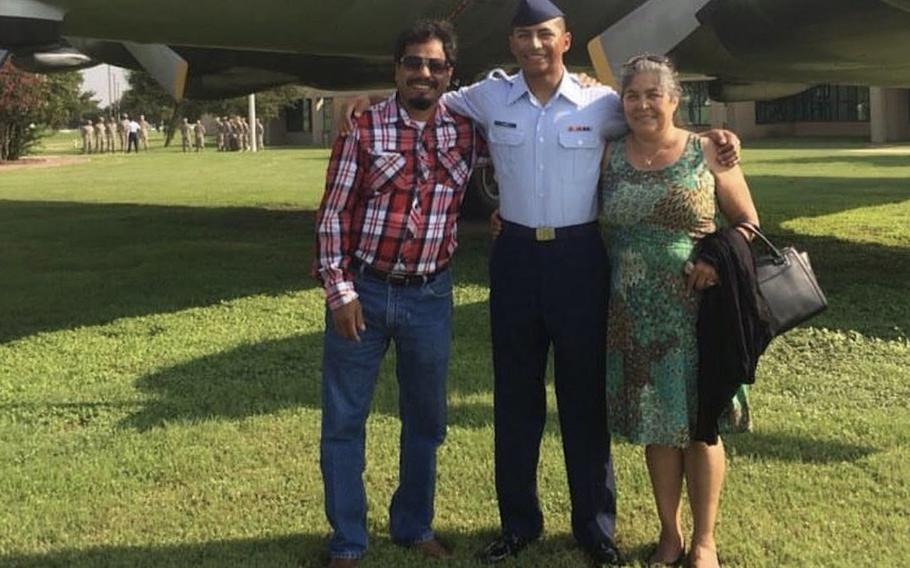 U.S. Air Force Staff Sgt. Caesar Flores, center, with his father, Andres Flores, and mother Juana Flores, who was deported to Mexico in 2018 after spending 30 years in the U.S.