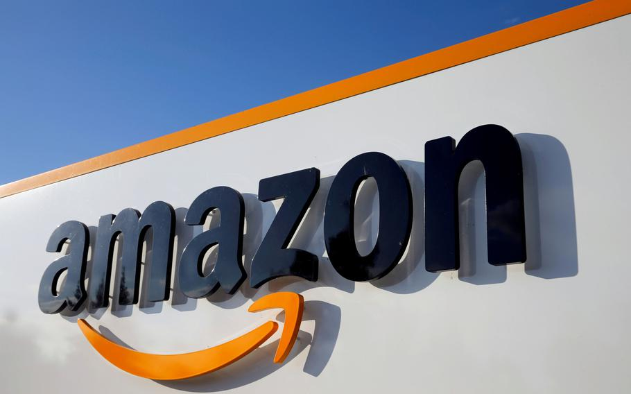 The logo of Amazon is seen at a company logistics center on August 8, 2018.