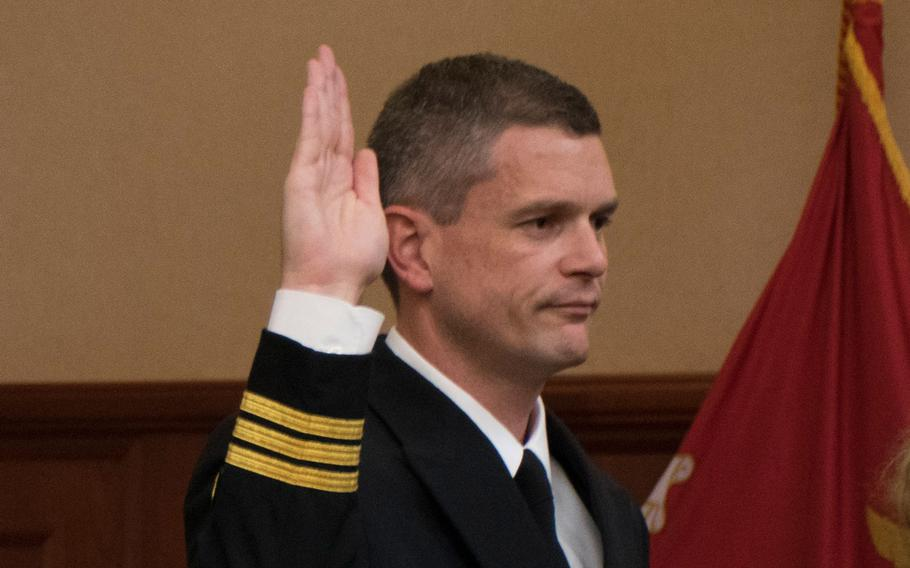Cmdr. Aaron Rugh is sworn into the Navy and Marine Court of Criminal Appeals (NMCCA) during an investiture ceremony at the Washington Navy Yard on Oct. 28, 2015.