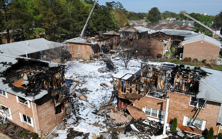 Firefighting foam covers the scene at a Virginia Beach, Va., apartment complex where a Navy F/A-18D Hornet crashed on April 6, 2012.