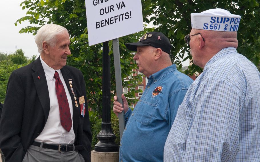 U.S. Navy Blue Water Vietnam veterans gathered near the U.S. Capitol on May 18, 2016, to rally in support of passage of a bill to regain benefits related to Agent Orange exposure. Col. Don Kaiserman, far left, past-president of Military Officers Association of America, stops to chat with two Vietnam veterans, Len Brzozowki, center, and Mike Yates.