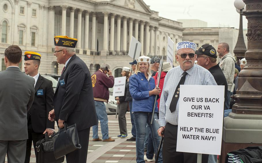 Mike Yates holds a poster as he and other advocates gather on Capitol Hill in Washington, D.C., on Wednesday, May 18, 2016, to promote the Blue Water Navy Vietnam Veterans Act.
