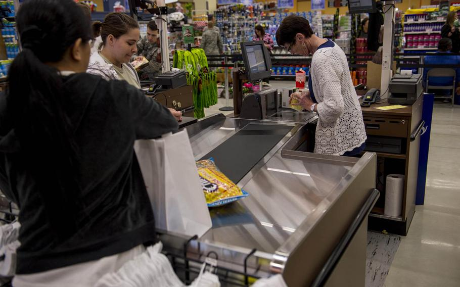 A customer checks out at the cash register inside the new Spangdahlem commissary during the grand opening of the facility on Thursday, May 19, 2016, at Spangdahlem Air Base, Germany. Commissaries are among the facilities struggling with the hiring freeze.