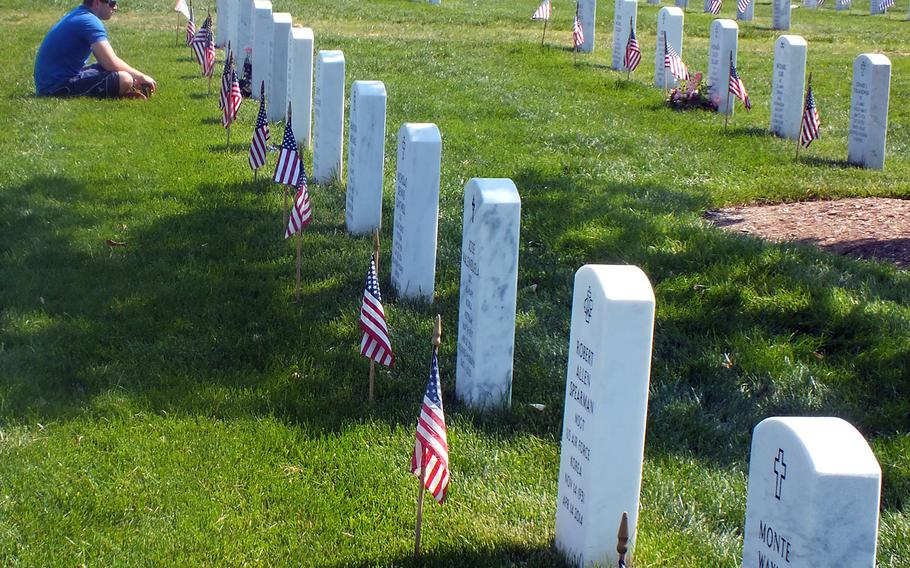Quiet contemplation at Arlington National Cemetery on Memorial Day weekend 2016.