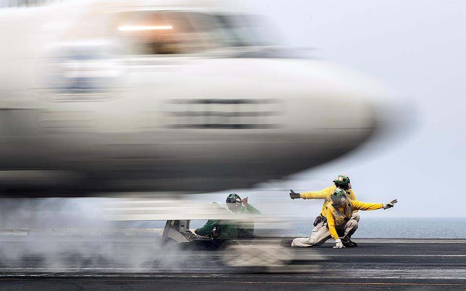 Sailors signal the launch of an E-2C Hawkeye from the flight deck of the aircraft carrier USS Harry S. Truman on April 13, 2016. Airstrikes against Islamic State militants were launched Friday, June 3, 2016, from the Truman while it was operating in the Eastern Mediterranean, according to the European Command.