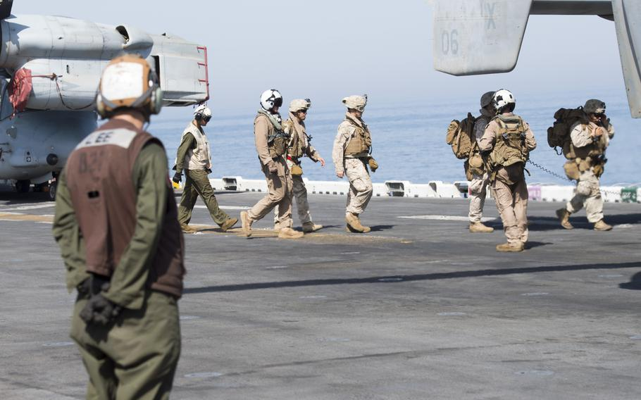 13th Marine Expeditionary Unit Marines file into an MV-22B Osprey onboard the amphibious assault ship USS Boxer on Thursday, June 16, 2016.