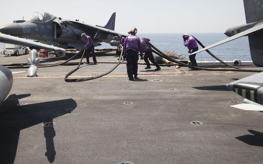 Refuelers on the deck of the amphibious assault ship USS Boxer on Thursday, June 16, 2016. The 13th Marine Expeditionary Unit's AV-8BII Harriers launched from the ship to conduct sorties against the Islamic State group.