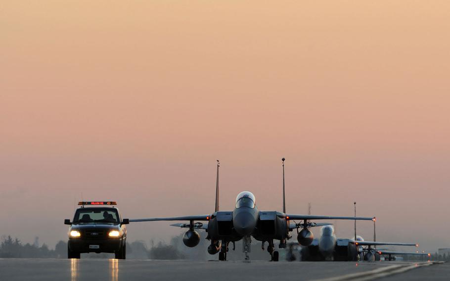 U.S. Air Force F-15E Strike Eagles taxi the runway after landing Nov. 12, 2015, at Incirlik Air Base, Turkey.