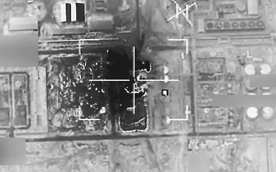 A video screen grab shows a coalition airstrike targeting Islamic State fighters near al-Qaim, Iraq, on April 29, 2016.