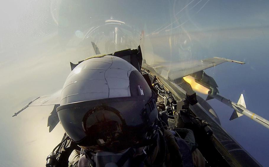Capt. Christopher Prout with Marine Fighter Attack Squadron (VMFA) 232, Marine Aircraft Group 11, 3rd Marine Aircraft Wing as he shoots an AIM-7 Sparrow missile from an F/A-18C Hornet near Tyndall Air Force Base, Florida, on May 16, 2013.