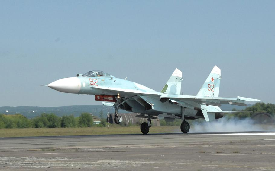 A Russian Federation Air Force SU-27 Flanker fighter lands on Aug. 8, 2011.