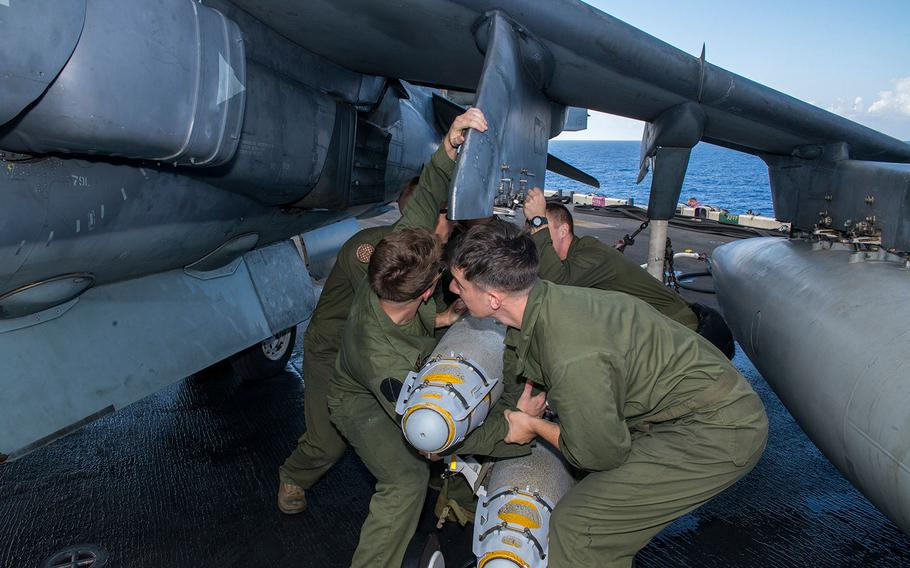 Marines attach a GBU-54 laser joint direct attack munition bomb to an AV-8B Harrier aboard the amphibious assault ship USS Wasp. The 22nd MEU, embarked on Wasp, is conducting precision air strikes in support of the Libyan Government of National Accord-aligned forces against Islamic State targets in Sirte, Libya as part of Operation Odyssey Lightning.