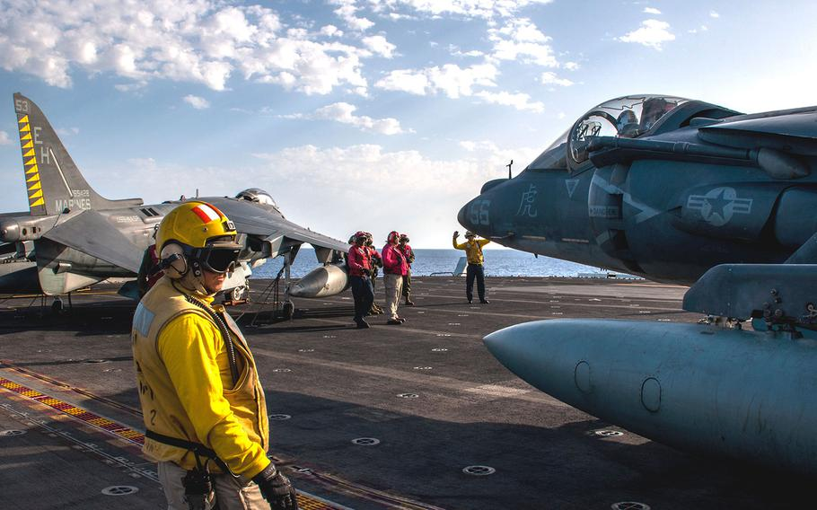 Sailors maneuver an AV-8B Harrier, from the 22nd Marine Expeditionary Unit, on the flight deck of the amphibious assault ship USS Wasp on Sept. 21, 2016.