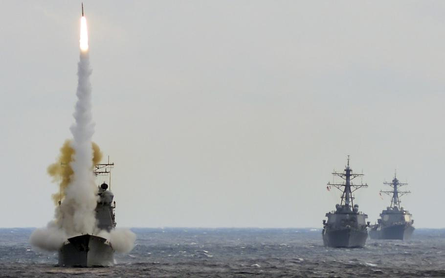 In a March, 2016 file photo, the guided-missile cruiser USS Monterey launches a Standard Missile-2 to destroy an advanced high-speed target while USS Stout and USS Mason transit formation during a live-fire test of the ship's Aegis weapons systems in the Atlantic Ocean. The Aegis system is credited with helping stop an attack on the Mason on Oct. 12, 2016 off Yemen.
