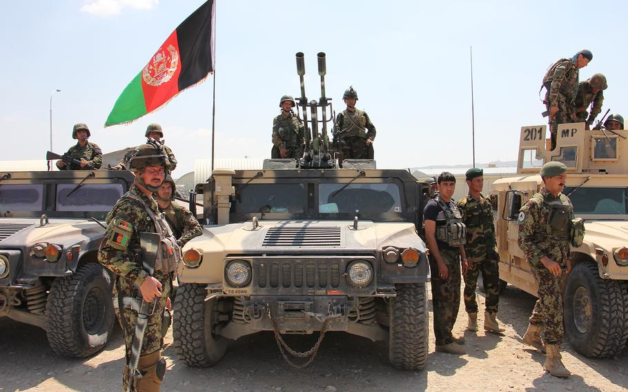Afghan National Army soldiers prepare to move out following an inspection of troops at the Regional Military Training Center at Tactical Base Gamberi, Afghanistan, on July 30, 2015.