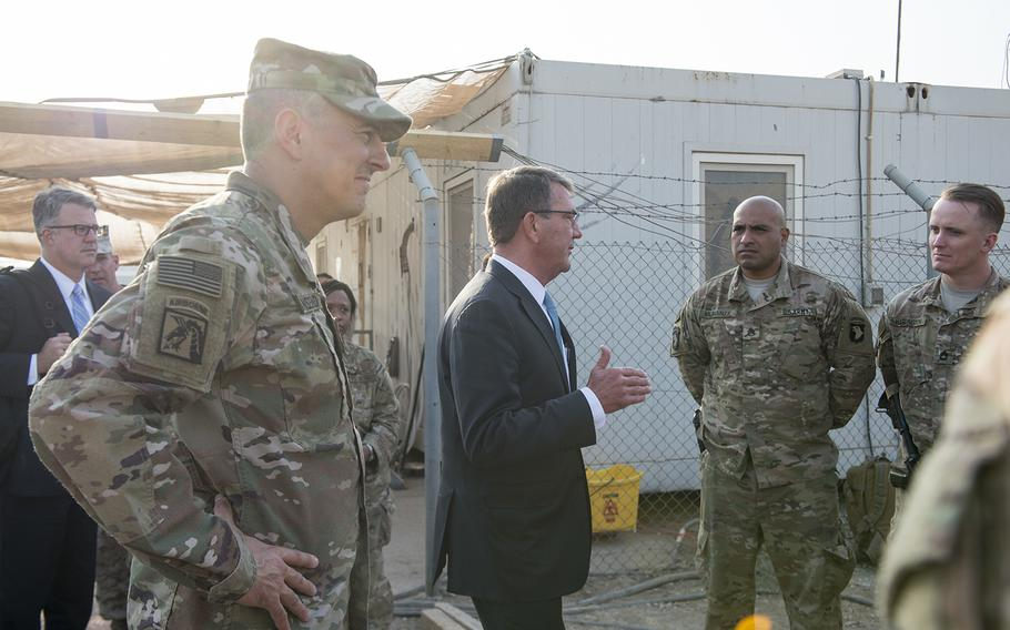 Secretary of Defense Ash Carter and U.S. Army Lt. Gen. Stephen Townsend, commander of Combined Joint Task Force-Operation Inherent Resolve, talk with members of the 101st Airborne Division in Irbil, Iraq, Oct. 23, 2016.