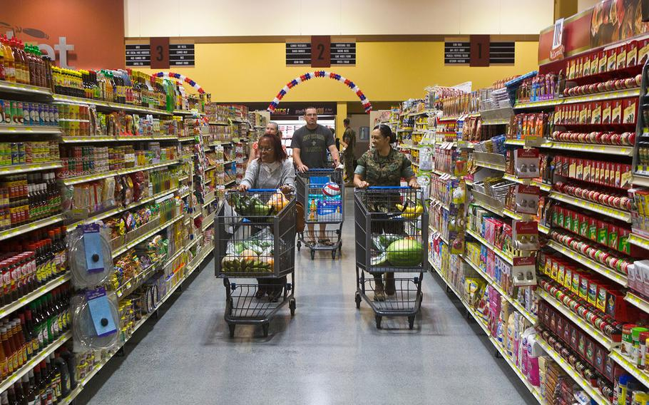 Customers walk through the new commissary at Marine Corps Air Station Iwakuni, Japan on June 21, 2016.