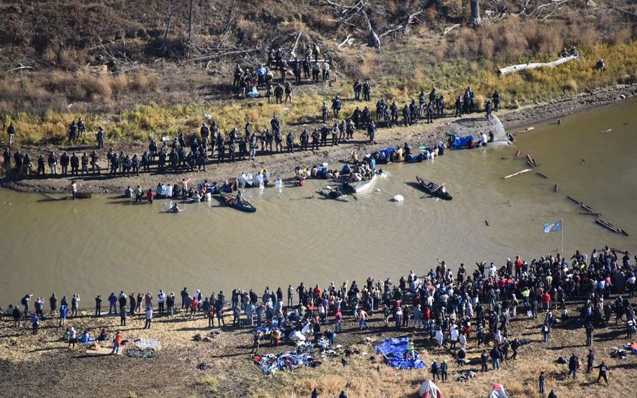 Police use pepper spray and tear gas to push demonstrators back as they try to cross a creek on Wednesday, Nov. 2, 2016, to prevent construction of the Dakota Access Pipeline.