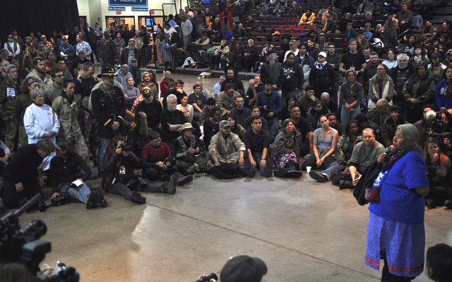 Tribal elder Faith Two Eagles addresses several hundred veterans inside Prairie Knights Casino and Resort on Monday, Dec. 5, 2016. The gathering wrapped up the veterans' visit to Standing Rock.