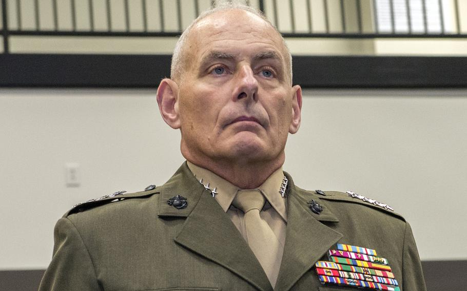 Marine Gen. John Kelly (now retired) stands at attention during a change of command ceremony at the U.S. Southern Command headquarters in Doral, Fla., on Jan. 14, 2016.