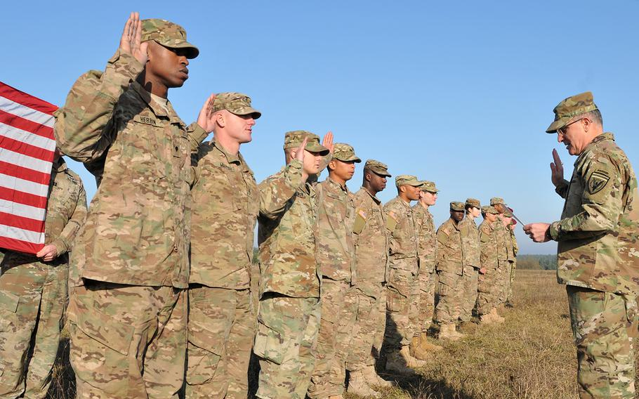 Army Gen. Curtis Scaparrotti, U.S. European Command Commander, reenlist Soldiers assigned to 6th Squadron, 8th Cavalry Regiment, 2nd Infantry Brigade Combat Team, 3rd Infantry Division, at the International Peacekeeping and Security Center, Nov. 23, 2016. Scaparrotti was here to interact with soldiers and observe Ukrainian soldiers during their 55-day training rotation at the Joint Multinational Training Group-Ukraine.