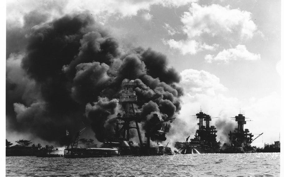 Burning and damaged ships are seen at Pearl Harbor on Dec. 7 1941.