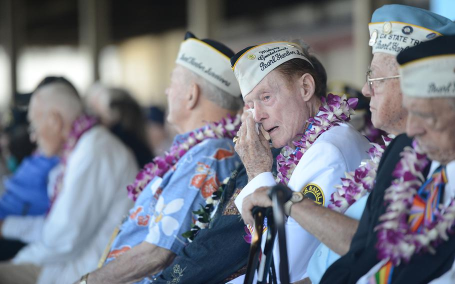 A Pearl Harbor survivor wipes tears from his eyes during the 75th Commemoration of the attack on Pearl Harbor at Kilo Pier on Joint Base Pearl Harbor-Hickam, on Dec. 7, 2016.