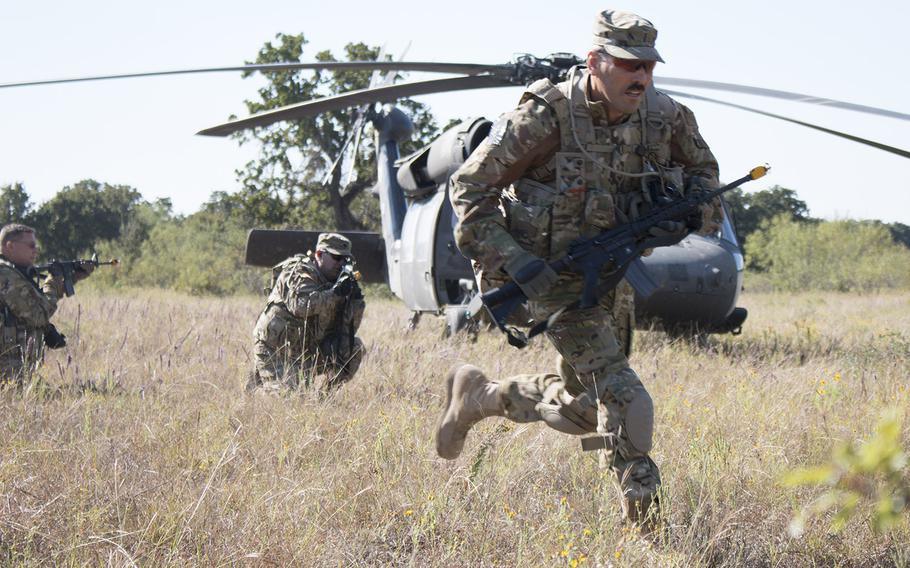 In an October, 2015 file photo, soldiers from the California Army National Guard's 40th Combat Aviation Brigade hit the ground running during a small unit tactics exercise at Fort Hood, Texas.