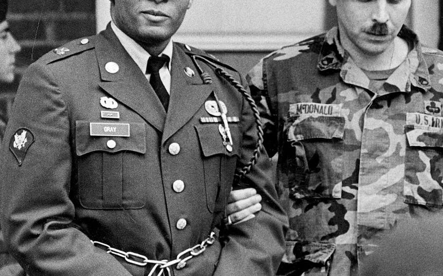 In this April 6, 1988, file photo, Ronald Gray leaves a courtroom escorted by military police at Fort Bragg, N.C.