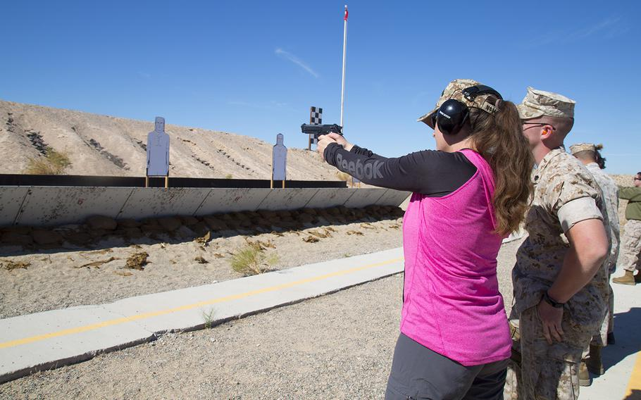 Jamie Teale takes aim during a shooting competition held at the pistol range at Marine Corps Logistics Base Barstow, Calif., Oct. 14, 2016. Legislation introduced Thursday would make it easier for military spouses to purchase guns wherever their active-duty husband or wife is stationed.