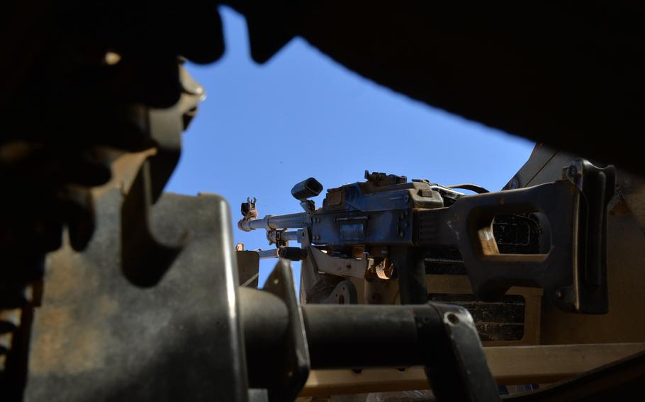 A PK machine gun is pictured here in the turret of an Iraqi army Humvee, Nov. 19, 2016. Amnesty International found that Iraqi army weapons supplied by the U.S., Russia and other countries have gotten into the hands of Iran-backed Shiite militias accused of committing war crimes in the campaign to rout the Islamic State group from Iraq.