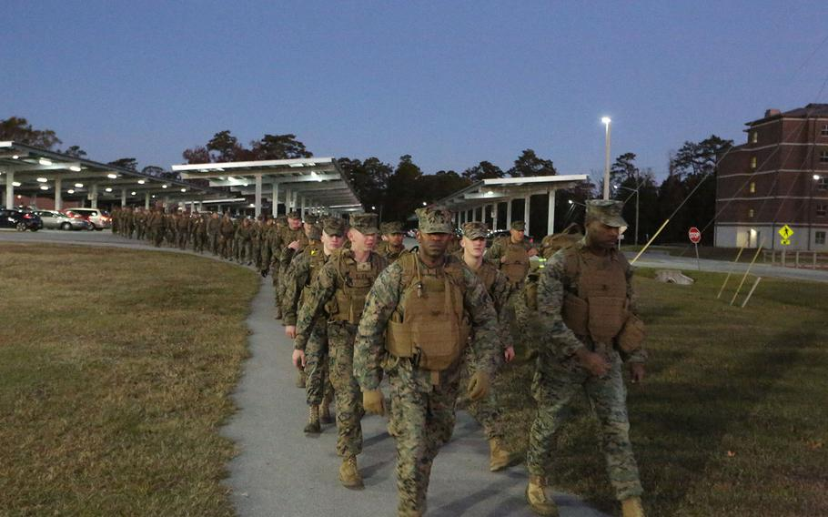 Marines commence a 7-mile conditioning hike at Camp Lejeune, N.C. on Nov. 22, 2016.