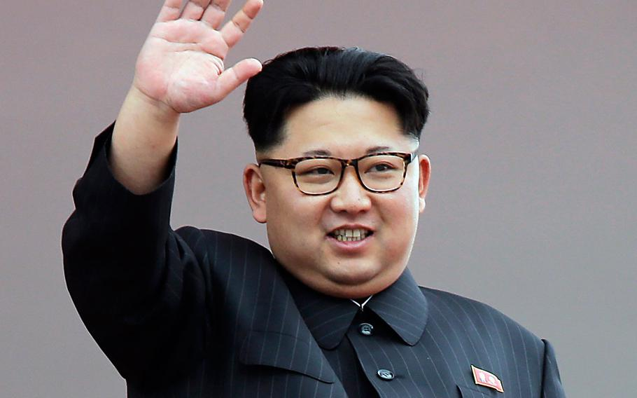 """North Korean leader Kim Jong Un waves at parade participants at the Kim Il Sung Square in Pyongyang, North Korea, May 10, 2016. Kim said in his New Year address that his country was in the """"last stages"""" of development for a launch."""