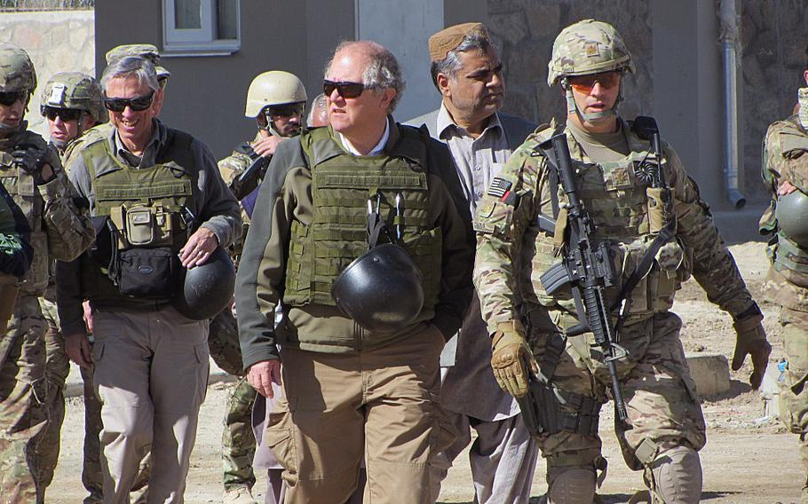 In this file photo, John Sopko, Special Inspector General for Afghanistan Reconstruction, center, tours facilities in Afghanistan. Sopko on Wednesday harshly criticized the lack of progress in the two years since NATO ended its combat mission, expressing the hope that his agency's assessment would help guide White House and congressional policymaking in the coming year.