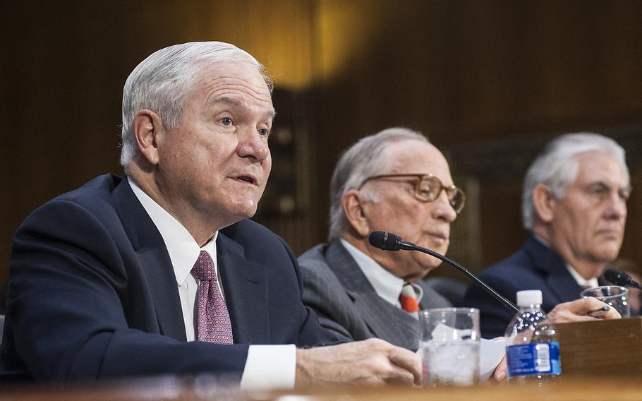 Former Defense Secretary Robert Gates gives his endorsement of Rex Tillerson, whom President-elect Donald Trump selected to become the next secretary of state, during a Senate Foreign Relations Committee hearing on Capitol Hill in Washington, D.C., on Wednesday, Jan. 11, 2017. Tillerson, at right, and former Senator Sam Nunn listen in the background.