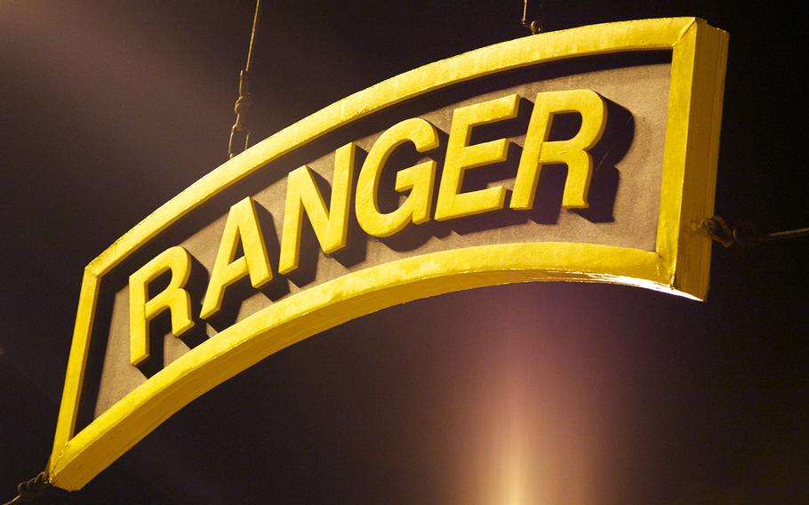 A sign in the shape of the U.S. Army Ranger tab hangs above the training area at Fort Benning, Ga., in April, 2014.
