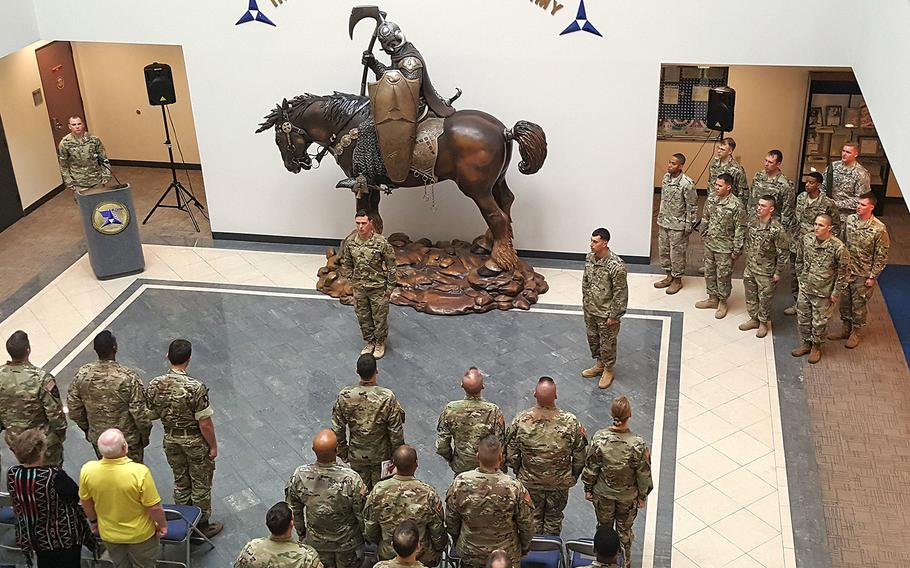 Soldiers with Delta Company, 52nd Infantry Regiment (Long Range Surveillance) conduct their unit's deactivation ceremony Jan. 10, 2017 inside the III Corp building at Fort Hood, Texas.