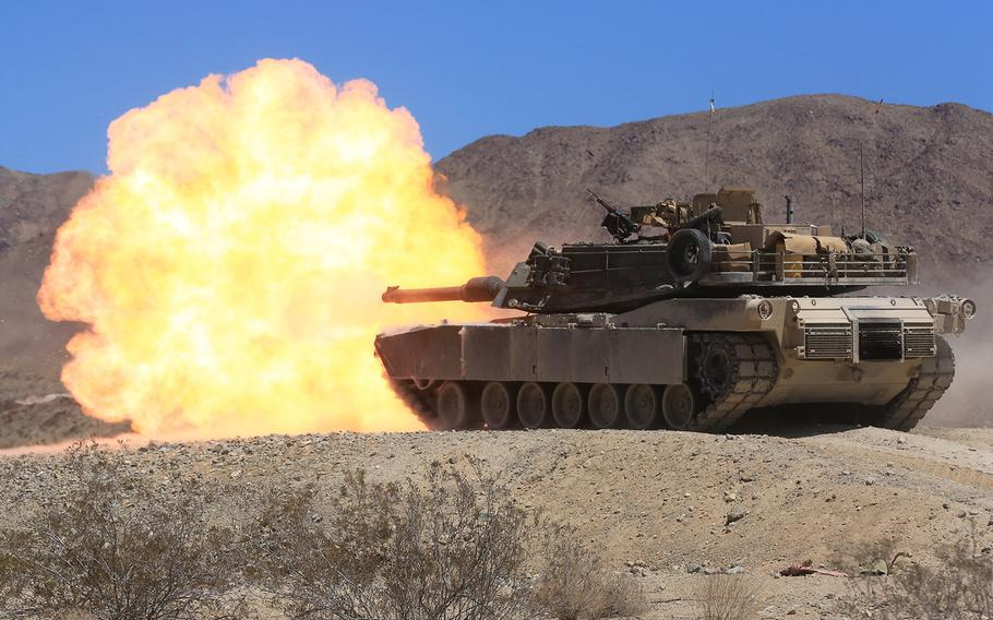 """An M1A1 Abrams Main Battle Tank crew fires its 120 mm main gun at Twentynine Palms, Calif., Aug. 4, 2015. A recent Congressional Research Service report said the automatic-loading 125-mm guns on the Chinese MBT-3000 and the Russian T-14 Armata could """"theoretically offer greater range and armor penetration"""" than the American 120-mm."""