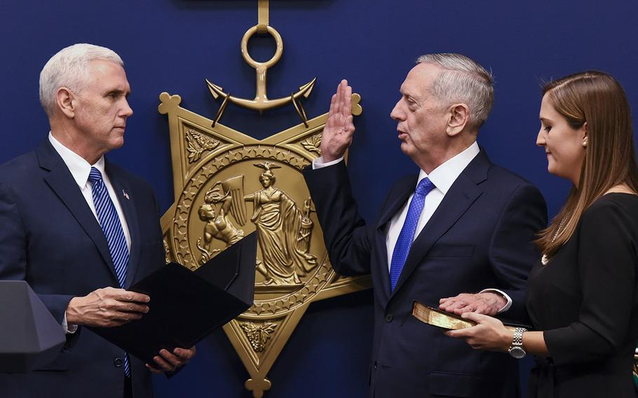 Defense Secretary Jim Mattis is sworn in by Vice President Mike Pence in a ceremony Friday in the Pentagon's Hall of Heroes. Mattis, a retired Marine general, was confirmed Jan. 20 by the Senate to serve as the nation's 26th Pentagon chief.