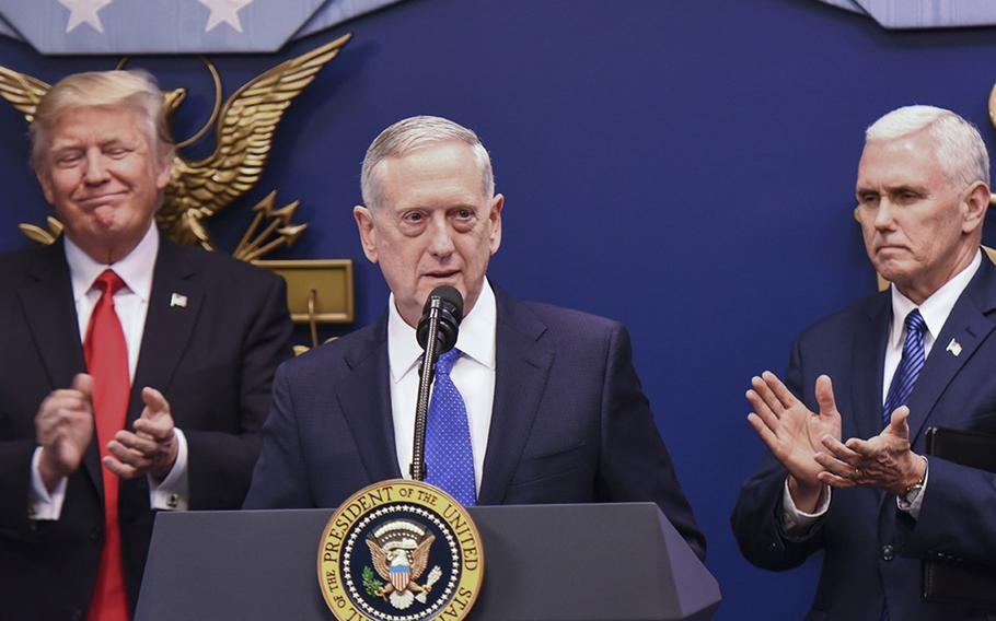 Defense Secretary Jim Mattis speaks after his ceremonial swearing-in Friday at the Pentagon. President Donald Trump and Mike Pence look on.