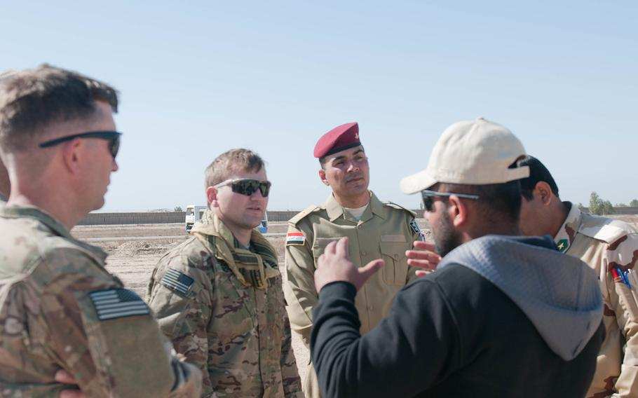 An interpreter translates for U.S. and Iraqi EOD teams while they observe a field test March 2, 2007, at Besmaya Range Complex, Iraq.
